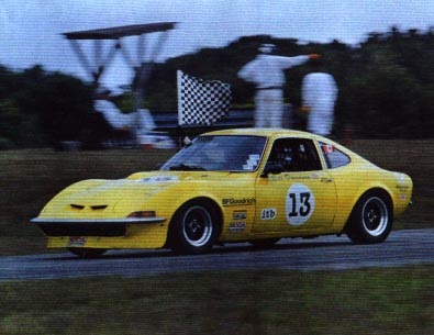 Yellow ITB Opel GT with checkered flag