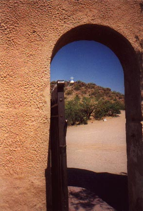 Hill view through archway at San Xavier [Yashica T4S]